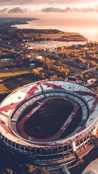 Обои на телефон футбол, стадион, река, монументальный