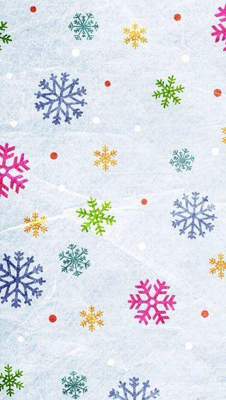 Обои на телефон снежинки, красочные