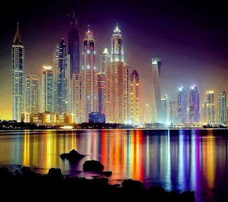 Обои на телефон море, ночь, небоскребы, дубай, город